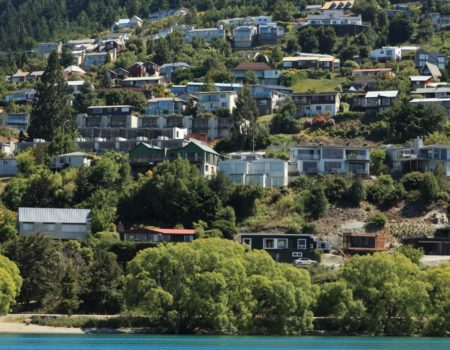 Queenstown houses on hill by lake