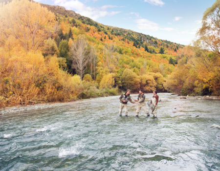 fly fishing in river in Arrowtown