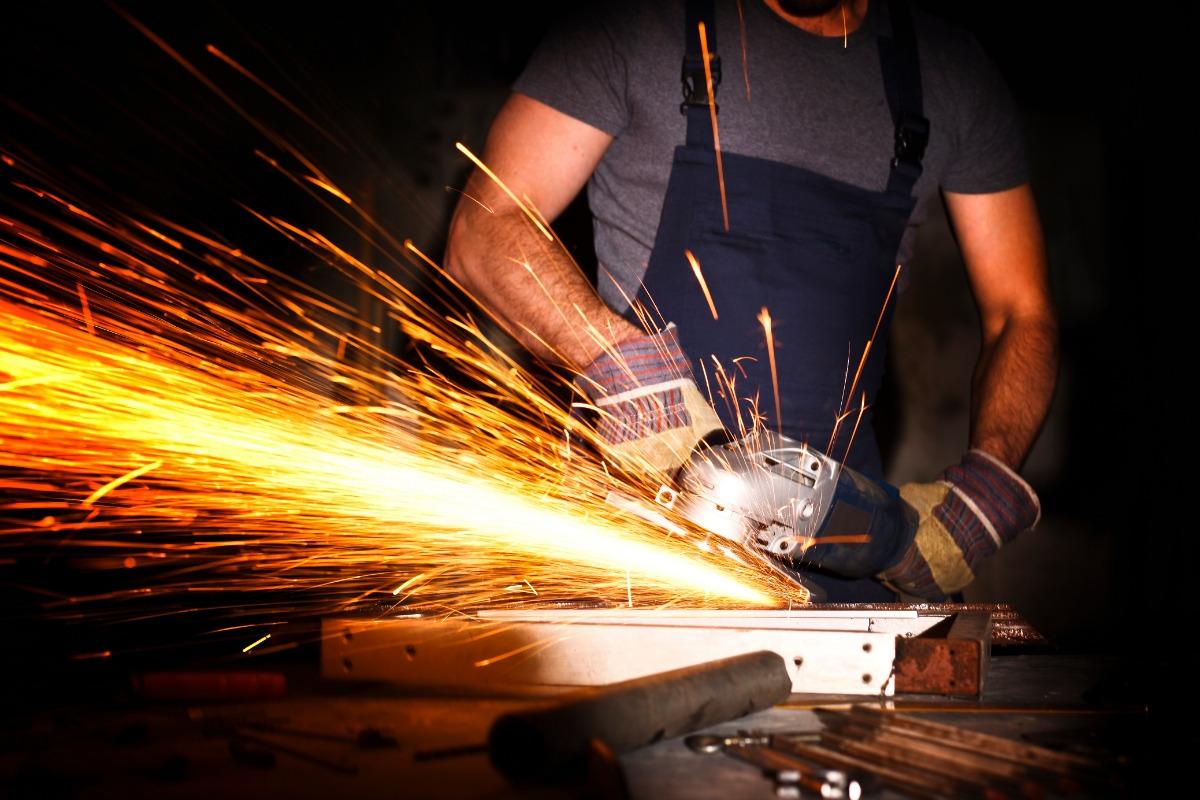 tradesman using grinder