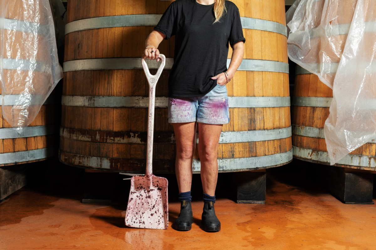 winery worker with shovel