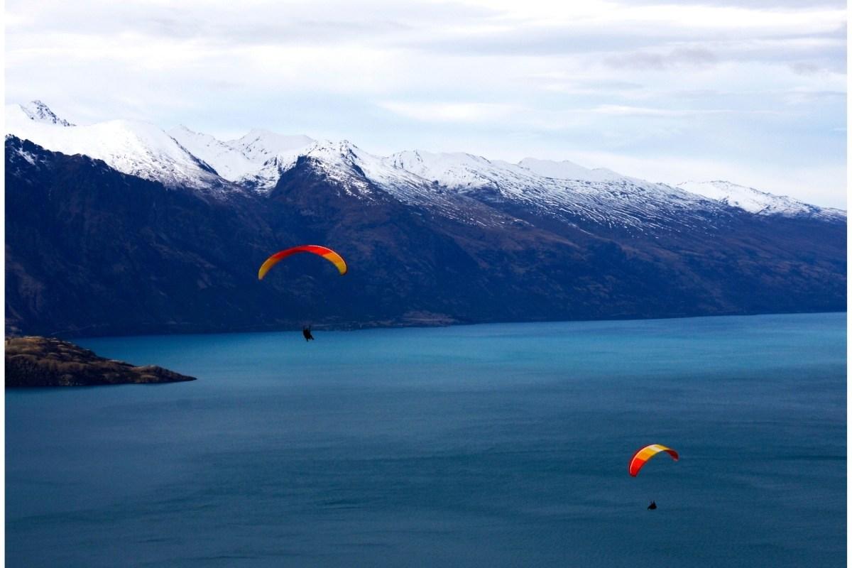 paragliders over lake wakatipu